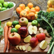A beautiful array of healthy fruit and vegetables with apples at the centre (as they should be)