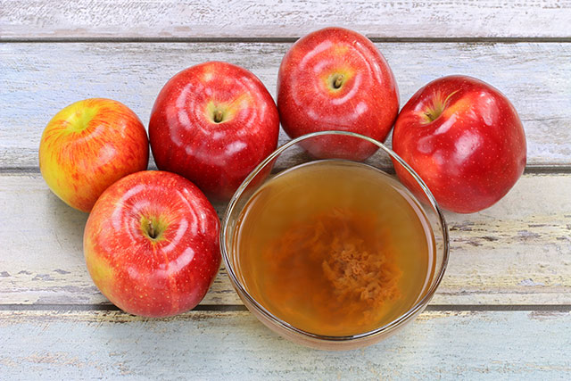 Red apples juiced and then fermented to create CoralTree organic Apple Cider Vinegar ACV